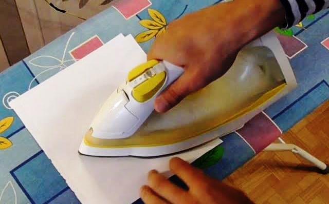 Удаление солярки с помощью утюга и бумаги